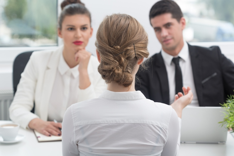 Picture of Young woman and recruitment procedure in corporation.
